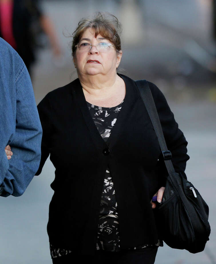 In this Oct. 8, 2013 file photo, Annette Bongiorno, longtime secretary of imprisoned financier Bernard Madoff, arrives to federal court in New York. Bongiorno and four other back-office subordinates of Madoff are accused of aiding the disgraced financier in one of history's biggest frauds. (AP Photo/Seth Wenig, File) / AP