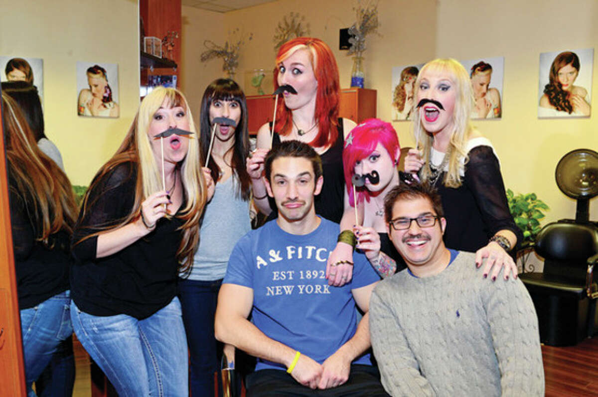 @Cutline Byline:Hour photo / Erik Trautmann At left, Styllin' Salon owner Emilie Forcellina and employees Sara Saja, Amy Holomakoff, Alyssa Wiener, Holly Guimares and customer Tom Romano and Michael Flores are participating in this moustache-growing global charity event in to help raise money and awareness for men's health issues and the Movember Foundation.