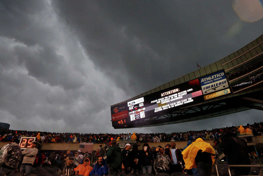 Fans are advised to leave the stadium as severe weather passes over Soldier Field during the first half of an NFL football game between the Chicago Bears and the Baltimore Ravens, Sunday, Nov. 17, 2013, in Chicago. (AP Photo/Charles Rex Arbogast) / AP
