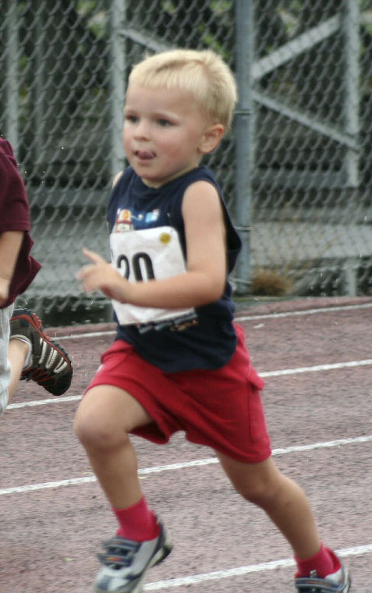 In this 2009 file photo provided by the Kowalski family, Chase Kowalski, at 2½ years old, runs in a race at Bethel High School in Bethel, Conn. Chase Kowalski loved to race, whether it was running, swimming or riding his bike. The 7-year-old, one of 26 people killed last Dec. 14 inside the Sandy Hook Elementary school, ran competitively for the first time when he was just 2½ years old. His parents decided to honor Chase?'s memory by a starting a foundation, raising money for children?'s fitness projects, family wellness and preschool education scholarships. (AP Photo/Kowalski family)