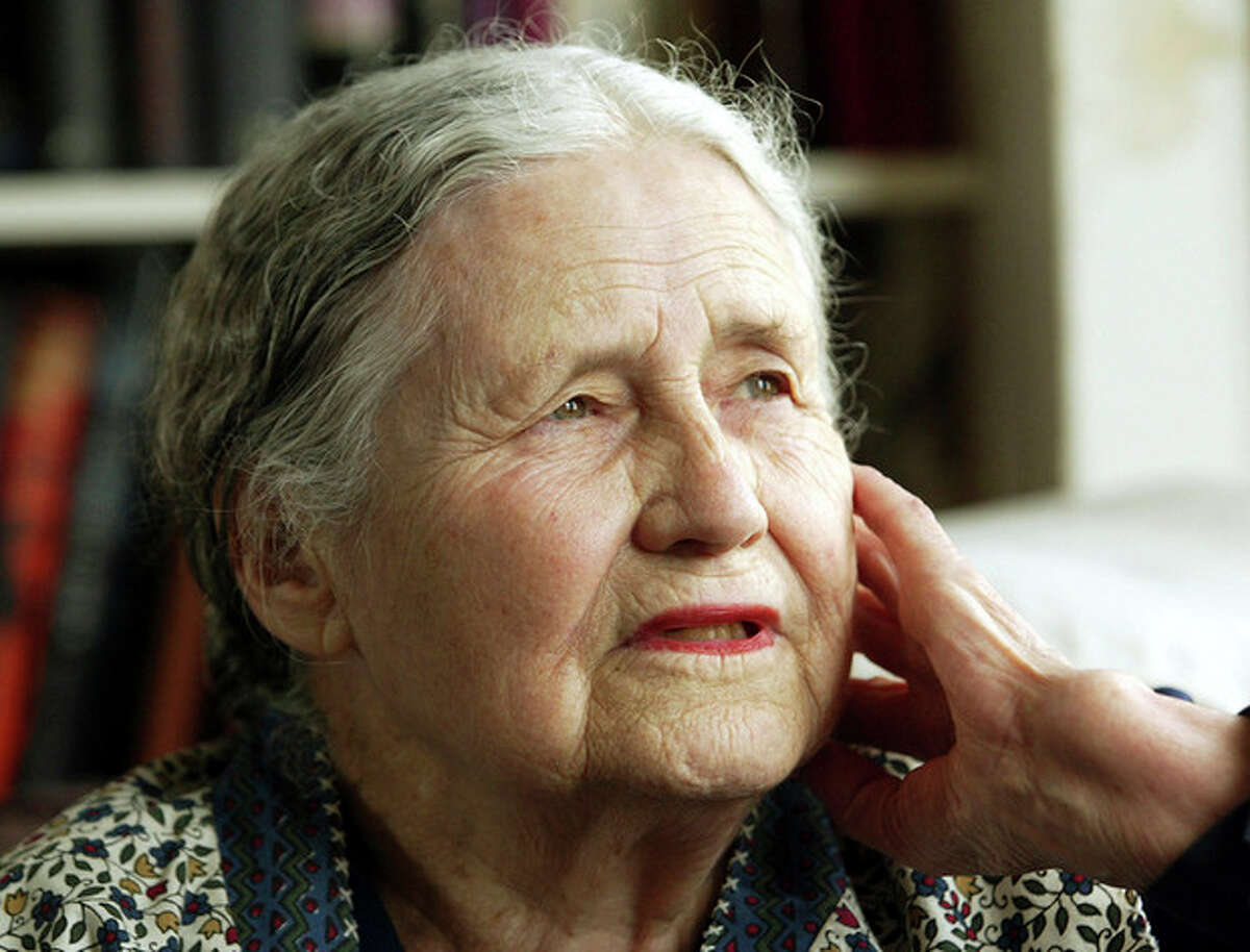 """FILE - In this April 17, 2006 file photo, Writer Doris Lessing, 86, sits in her home in north London. Doris Lessing, the free-thinking, world-traveling, often-polarizing writer of """"The Golden Notebook"""" and dozens of other novels that reflected her own improbable journey across the former British empire, has died, early Sunday, Nov. 17, 2013. She was 94. The author of more than 50 works of fiction, nonfiction and poetry, Lessing explored topics ranging from colonial Africa to dystopian Britain, from the mystery of being female to the unknown worlds of science fiction. (AP Photo/Martin Cleaver, File)"""