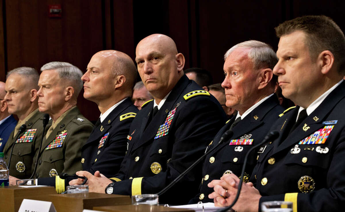 FILE - In this June 4, 2013, file photo, military leaders, from right, legal counsel to the Chairman of the Joint Chiefs of Staff Brig. Gen. Richard C. Gross, Joint Chiefs Chairman Gen. Martin Dempsey, Army Chief of Staff Gen. Ray Odierno, Judge Advocate General of the Army Lt. Gen. Dana K. Chipman, Commandant of the Marine Corps Gen. James F. Amos, and Staff Judge Advocate to the Marine Corps Commandant Maj. Gen. Vaughn A. Ary, testify at a Senate Armed Services Committee holds a hearing on Capitol Hill in Washington, about whether a drastic overhaul of the military justice system is needed. (AP Photo/J. Scott Applewhite, File)
