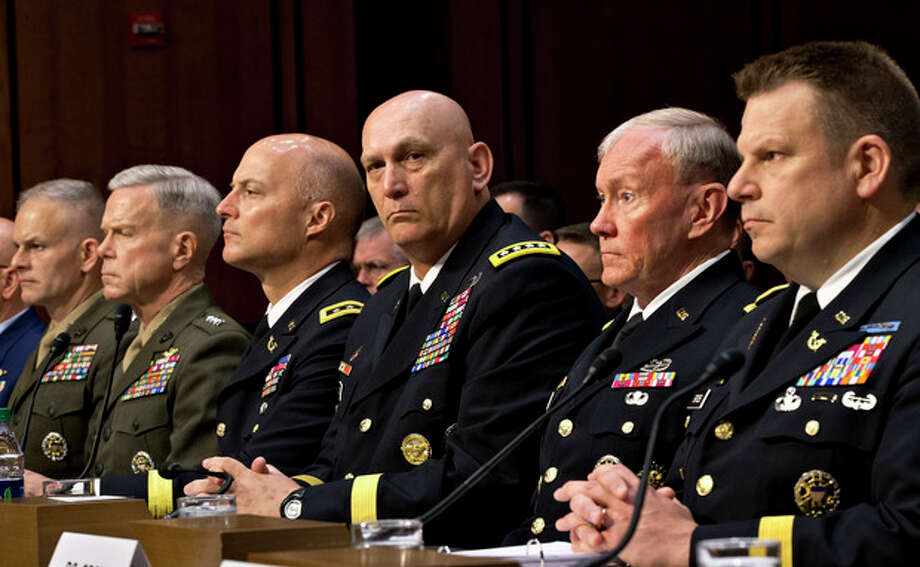 FILE - In this June 4, 2013, file photo, military leaders, from right, legal counsel to the Chairman of the Joint Chiefs of Staff Brig. Gen. Richard C. Gross, Joint Chiefs Chairman Gen. Martin Dempsey, Army Chief of Staff Gen. Ray Odierno, Judge Advocate General of the Army Lt. Gen. Dana K. Chipman, Commandant of the Marine Corps Gen. James F. Amos, and Staff Judge Advocate to the Marine Corps Commandant Maj. Gen. Vaughn A. Ary, testify at a Senate Armed Services Committee holds a hearing on Capitol Hill in Washington, about whether a drastic overhaul of the military justice system is needed. (AP Photo/J. Scott Applewhite, File) / AP