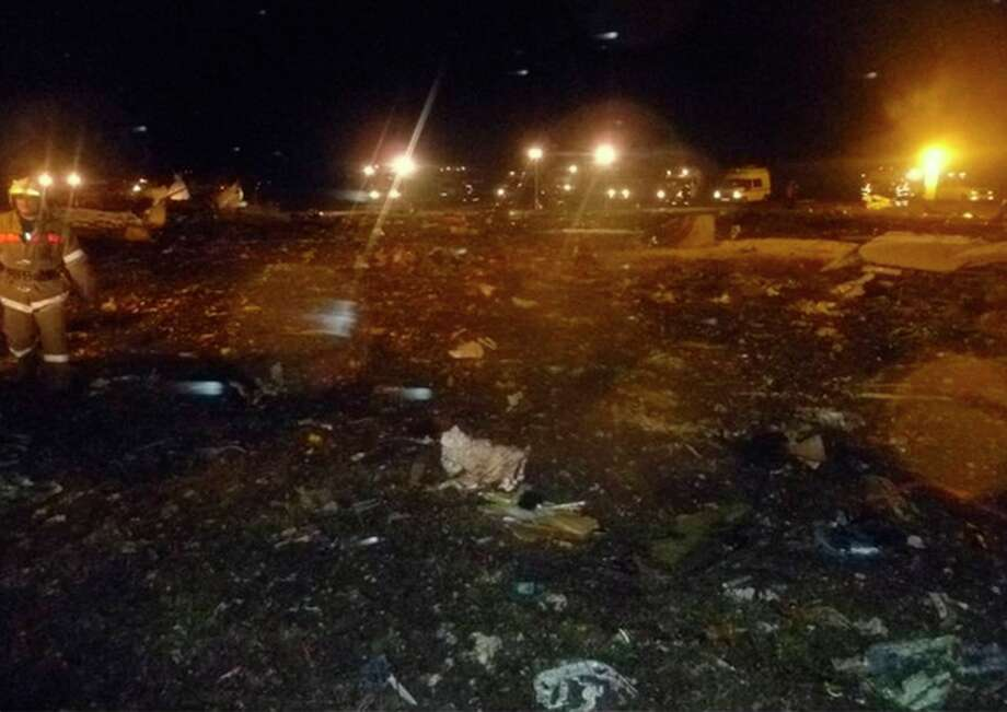 In this photo provided by Russian Emergency Situations Ministry shows the crash site of the Russian passenger airliner, Boeing 737, near Kazan, the capital of the Tatarstan republic, about 720 kilometers (450 miles) east of Moscow, Sunday, Nov. 17, 2013. A Russian passenger airliner crashed Sunday night while trying to land at the airport in the city of Kazan, killing everyone aboard, officials said. The Boeing 737 belonging to Tatarstan Airlines crashed an hour after taking off from Moscow. There were no immediate indications of the cause. (AP Photo/Russian Emergency Situations Ministry) / RUSSIAN EMERGENCY SITUATIONS MINISTRY