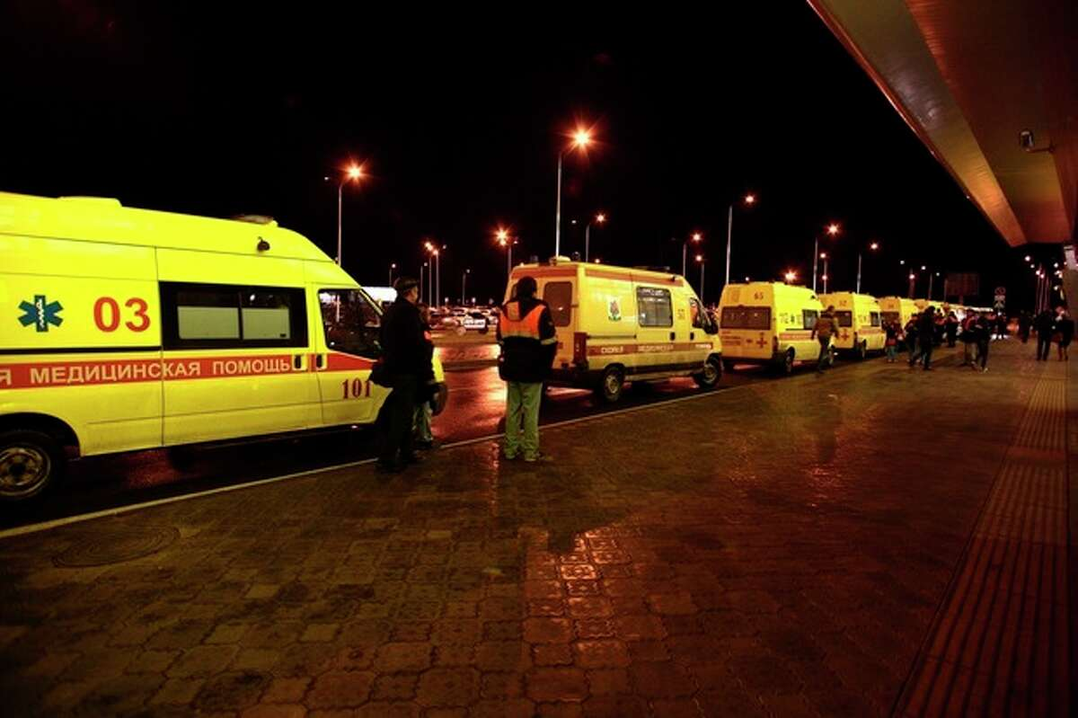 Ambulances line up in front of the airport building in Kazan, about 720 kilometers (450 miles) east of Moscow, where the Russian passenger airliner, Boeing 737, crashed Sunday, Nov. 17, 2013. A Russian passenger airliner crashed Sunday night while trying to land at the airport in the city of Kazan, killing all people aboard, officials said. The Boeing 737 belonging to Tatarstan Airlines crashed an hour after taking off from Moscow. There were no immediate indications of the cause. (AP Photo/Nikolai Alexandrov)