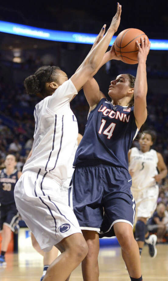 Connecticut's Bria Hartley (14) looks to shoot over Penn State's Ariel Edwards (23) in the second half of an NCAA college basketball game on Sunday, Nov. 17, 2013, in State College, Pa. Connecticut won 71-52. (AP Photo/John Beale)
