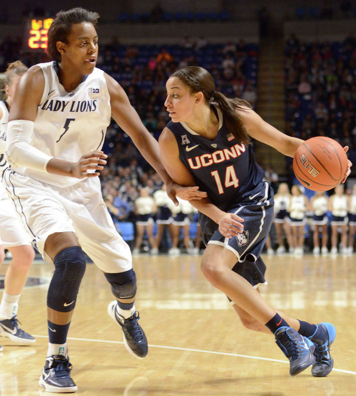 Connecticut's Bria Hartley (14) drives to the basket past Penn State's Talia East (5) in the first half of an NCAA college basketball game on Sunday, Nov. 17, 2013, in State College, Pa. Hartley had 29 points in Connecticut's 71-52 victory over Penn State. (AP Photo/John Beale)