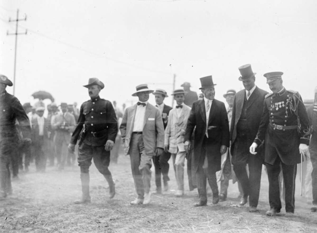 """In this July 1913 photo made available by the Library of Congress, President Woodrow Wilson, third from right, attends a commemoration for the 50th anniversary of the Battle of Gettysburg. After Abraham Lincoln, the first major presidential address at Gettysburg was given at this event by Wilson, who privately ranked Lincoln's speech as """"very, very high,"""" and offered a vague tribute to national unity that disappointed admirers of a man whose speechmaking had enabled his quick rise from Princeton president to the White House. According to a new biography by A. Scott Berg, Wilson was a reluctant guest of honor. He initially turned down an invitation and gave in only after being warned that the Virginia-born president would be perceived as hostile to a gathering attended by veterans from both sides. (AP Photo/Library of Congress)"""