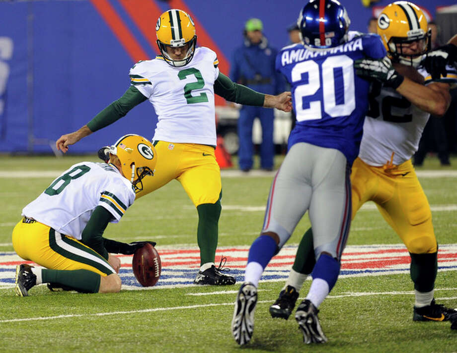 Green Bay Packers' Mason Crosby (2) kicks a field goal during the first half of an NFL football game Sunday, Nov. 17, 2013, in East Rutherford, N.J. (AP Photo/Bill Kostroun) / FR51951 AP