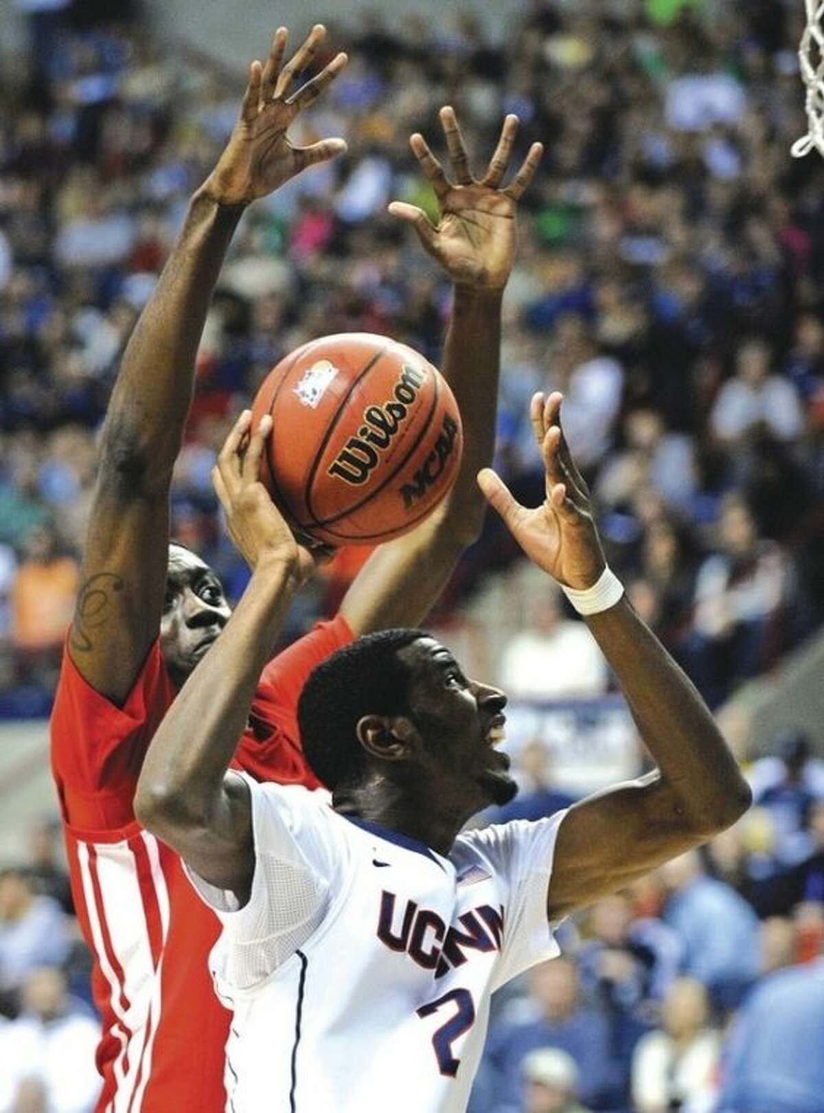 AP photo UConn's DeAndre Daniels (2) drives past Boston University's Malik Thomas during Sunday's game at Gampel Pavilion. Daniels had 24 points to lead the Huskies to a 77-60 victory in the game, part of the 2K Sports Classic.