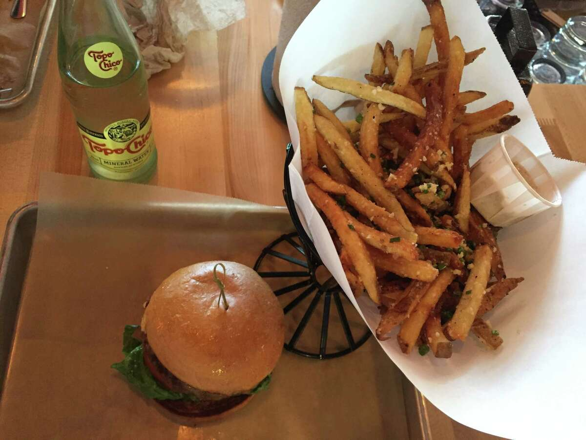 Goodnight / Good Cause burger with fries and Topo Chico at Hopdoddy Burger Bar.