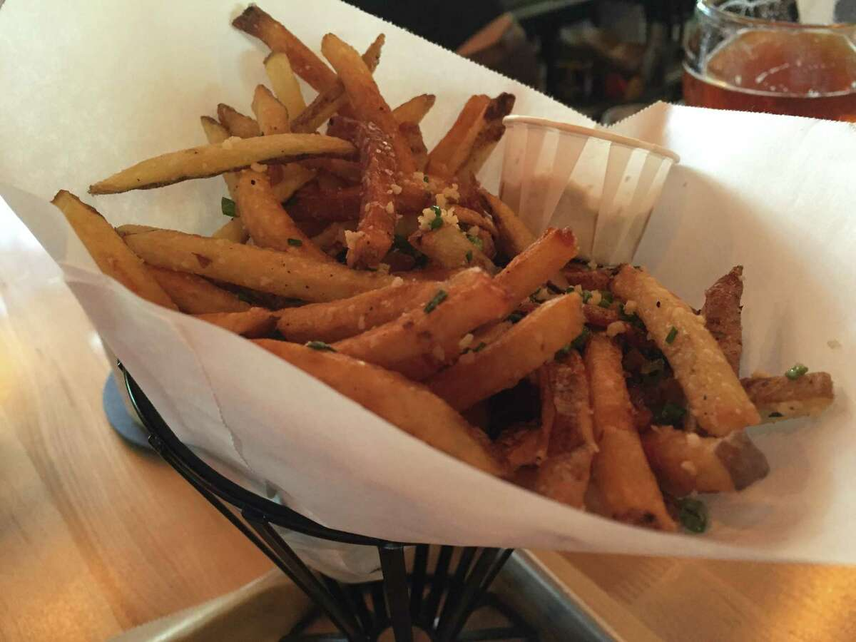 Kennebec fries, made from the Kennebec potato, are topped with Parmesan and minced herbs at Hopdoddy Burger Bar.