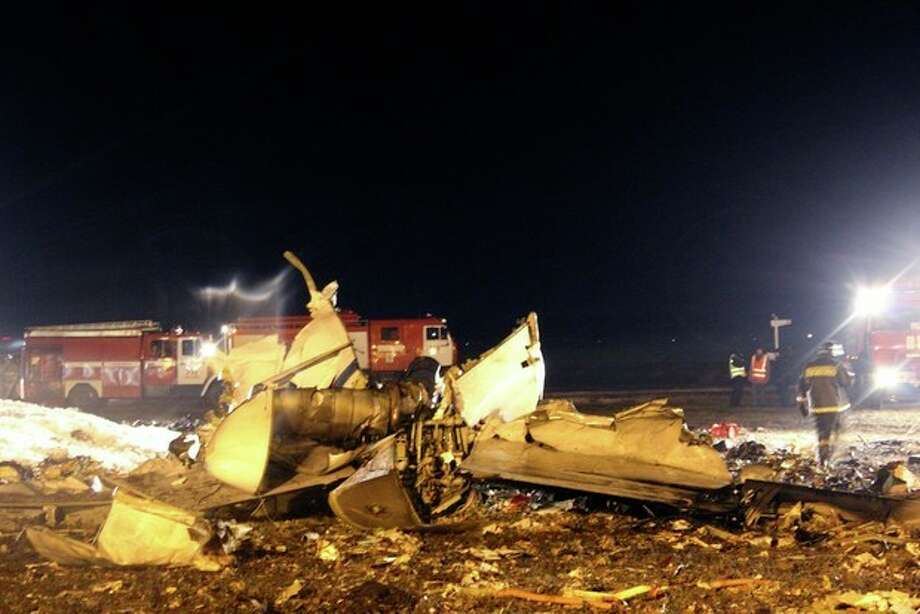 In this photo provided by Russian Emergency Situations Ministry fire fighters and rescuers work at the crash site of a Russian passenger airliner near Kazan, the capital of the Tatarstan republic, about 720 kilometers (450 miles) east of Moscow, Sunday, Nov. 17, 2013. A Russian passenger airliner crashed Sunday night while trying to land at the airport in the city of Kazan, killing all people aboard, officials said. The Boeing 737 belonging to Tatarstan Airlines crashed an hour after taking off from Moscow. There were no immediate indications of the cause. (AP Photo/Russian Emergency Situations Ministry) / RUSSIAN EMERGENCY SITUATIONS MINISTRY