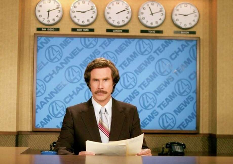"""FILE - This 2004 file photo originally released by Paramount Pictures shows Will Ferrell as anchorman Ron Burgundy in """"Anchorman: The Legend of Ron Burgundy."""" Emerson College is changing the name of its school of communication. The college in Boston will rename the school for one day only, the Ron Burgundy School of Communication on Dec. 4 to honor the fictitious television anchorman. Ferrell, in character, is scheduled to share his path to journalism greatness with students. His visit will include a news conference, the renaming ceremony and a screening of """"Anchorman 2: The Legend Continues."""" Ferrell, as himself, will introduce the movie. The sequel opens nationwide on Dec. 20. (AP Photo/Paramount Pictures, Frank Masi) / DREAMWORKS PICTURES"""