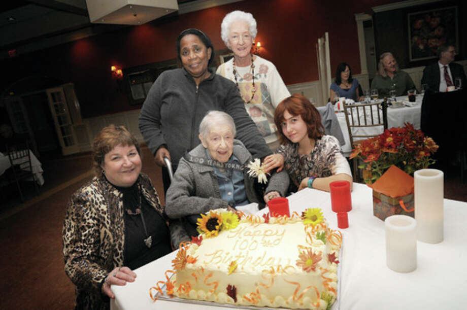 Hour photos / Matthew VinciAbove, Helen Henczel Sontra celebrates her 100th birthday Sunday at Oak Hills Restaurant. Alongside her is, from left, her niece Jodie Daher, Helen's live-in aide Theodora Williams, sister-in-law June Henczer and Danica Daher, daughter of Jodie Daher. Below, a close-up of the cake's decoration.