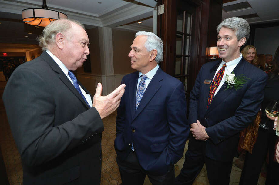 Wilton Business Person of the Year Stephen Summerton chats with Bobby Valentine with Tierney O'Hearn, the newly-elected president of the Wilton Chamber of Commerce, during the 24th annual dinner at Rolling Hills Country Club.