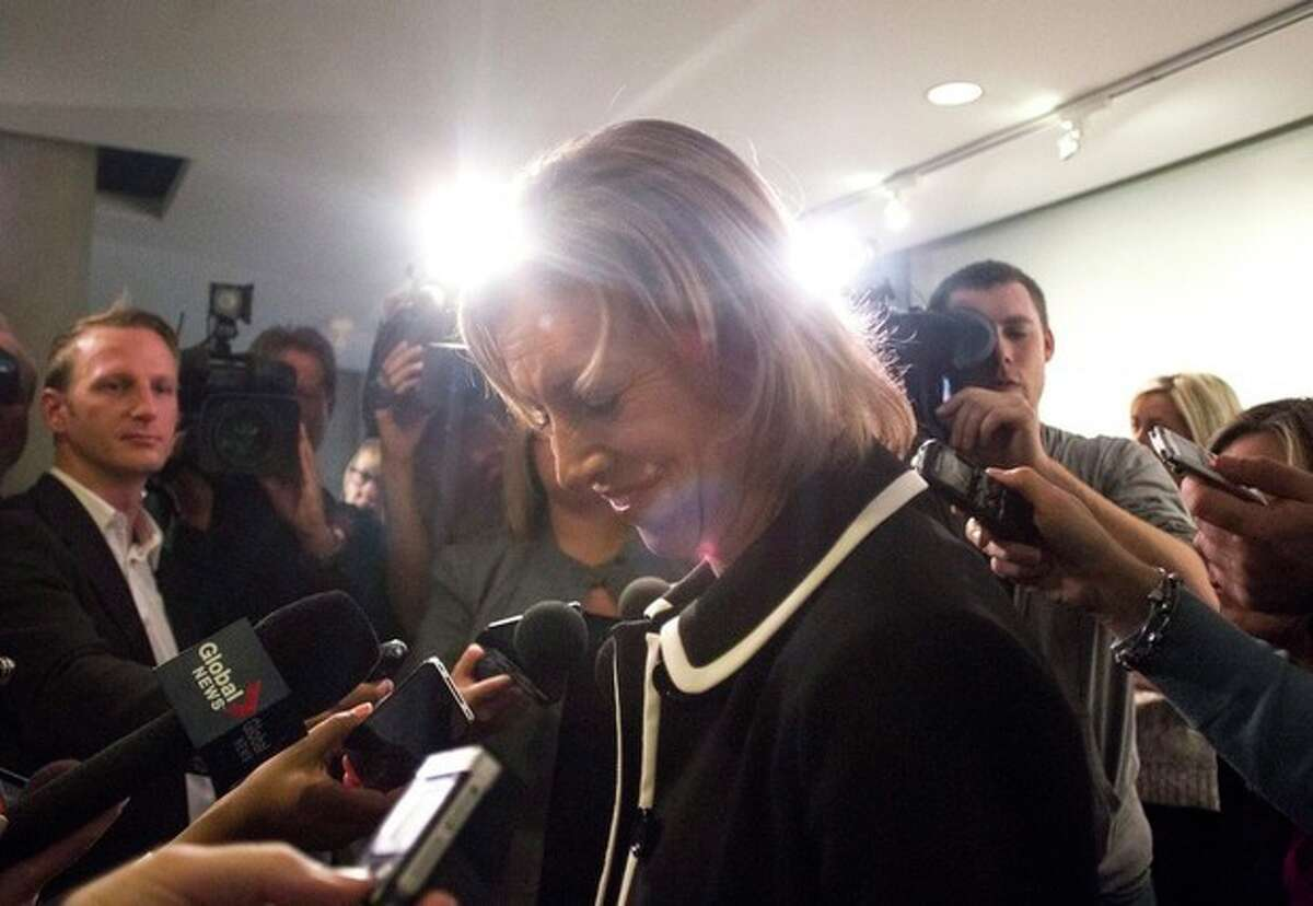 Toronto City Councillor and declared mayoral candidate Karen Stintz speaks to the media at city hall in Toronto on Monday, Nov. 18, 2013. Beset by scandal, Toronto Mayor Rob Ford, brother of Doug Ford, faces another likely setback, as the City Council takes up a motion to strip him of most of his remaining powers. Under the motion, already endorsed by a majority of council members, Rob Ford would in effect become mayor of Canada's largest city in name only. (AP Photo/The Canadian Press, Chris Young)