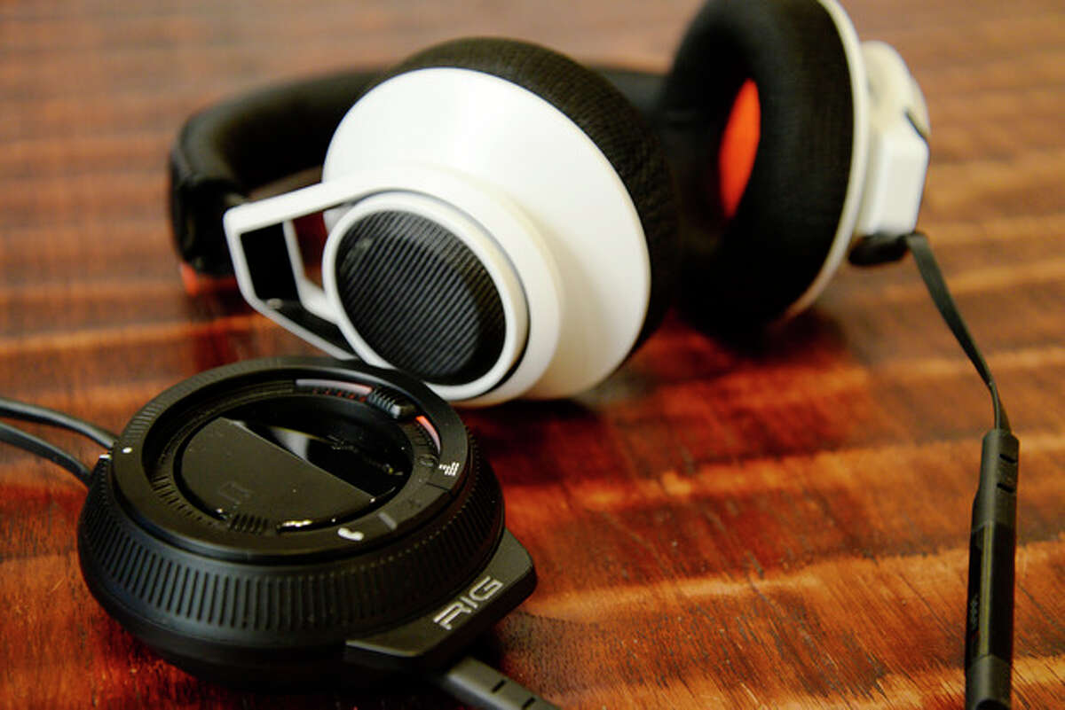 The Rig gaming headset from Plantronics is photographed on Nov. 18, 2013, in Decatur, Ga. It allows the user to connect a mobile phone to its mixer and toggle between phone calls and gaming audio. (AP Photo/Ron Harris)