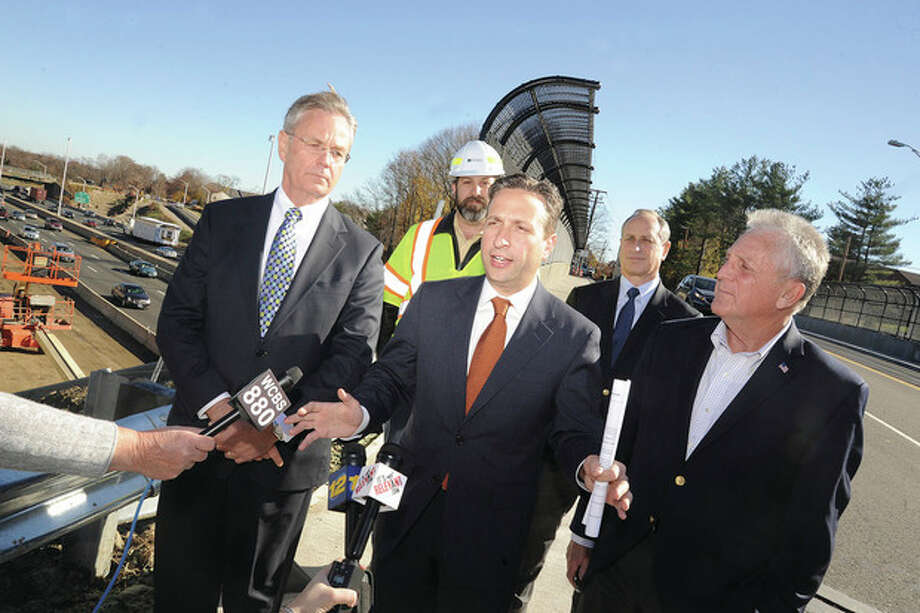 Hour photo/Matthew VinciState Sen. Bob Duff and Department of Transportation Commissioner James Redeker, along with Norwalk Mayor-elect Harry Rilling, HAKS Assistant Vice President William Slade and HAKS President and CEO Elliot Sander give an I-95 construction update Monday at the corner of Cedar Street and Connecticut Avenue.