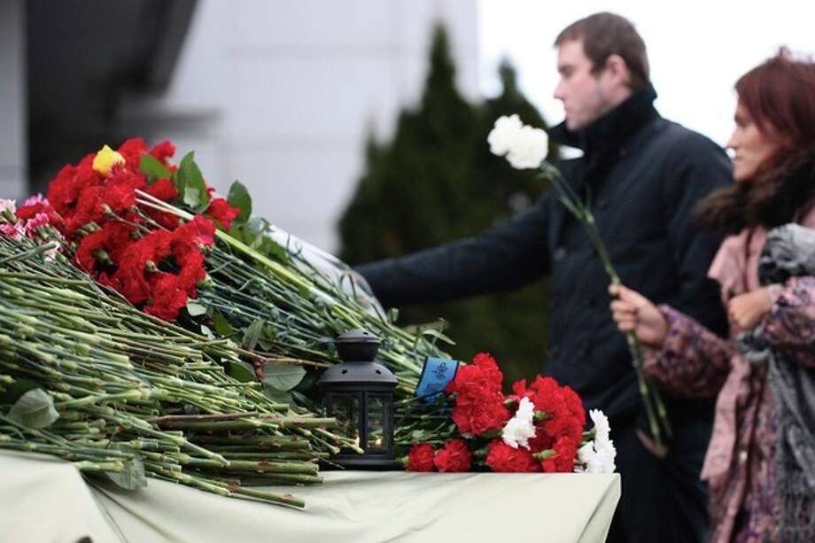 People place flowers in Kazan airport Monday, Nov. 18, 2013. A plane belonging to Tatarstan Airlines crashed Sunday while trying to land at its home port in the Russian city of Kazan, the capital of the oil-rich province of Tatarstan. The son of the provincial governor and the chief of the local branch of Russia's main security agency were among the victims. (AP Photo/ Nikolai Alexandrov) / AP