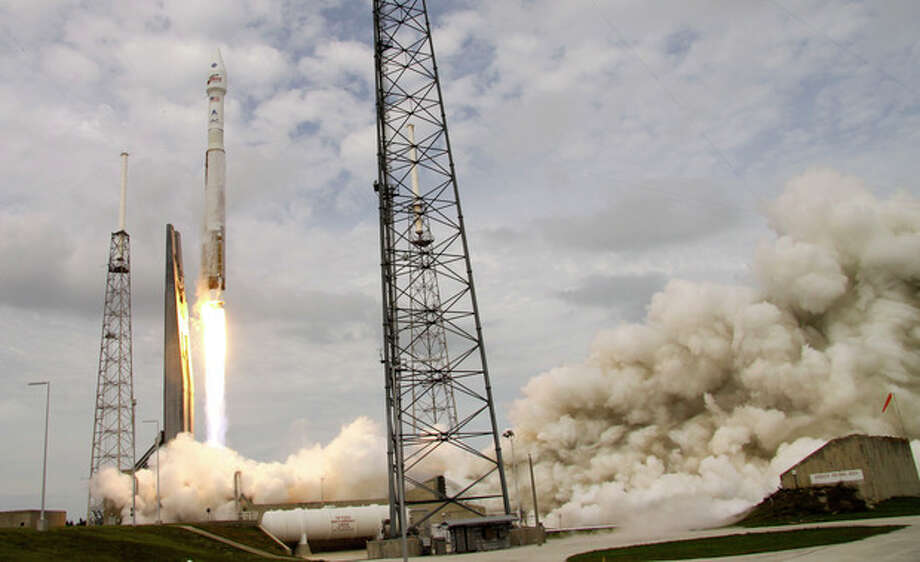 NASA's Maven, atop a United Launch Alliance Atlas 5 rocket, lifts off from Cape Canaveral Air Force Station, Monday, Nov. 18, 2013, in Cape Canaveral, Fla. The spacecraft will orbit Mars and study the planet's upper atmosphere. (AP Photo/John Raoux) / AP