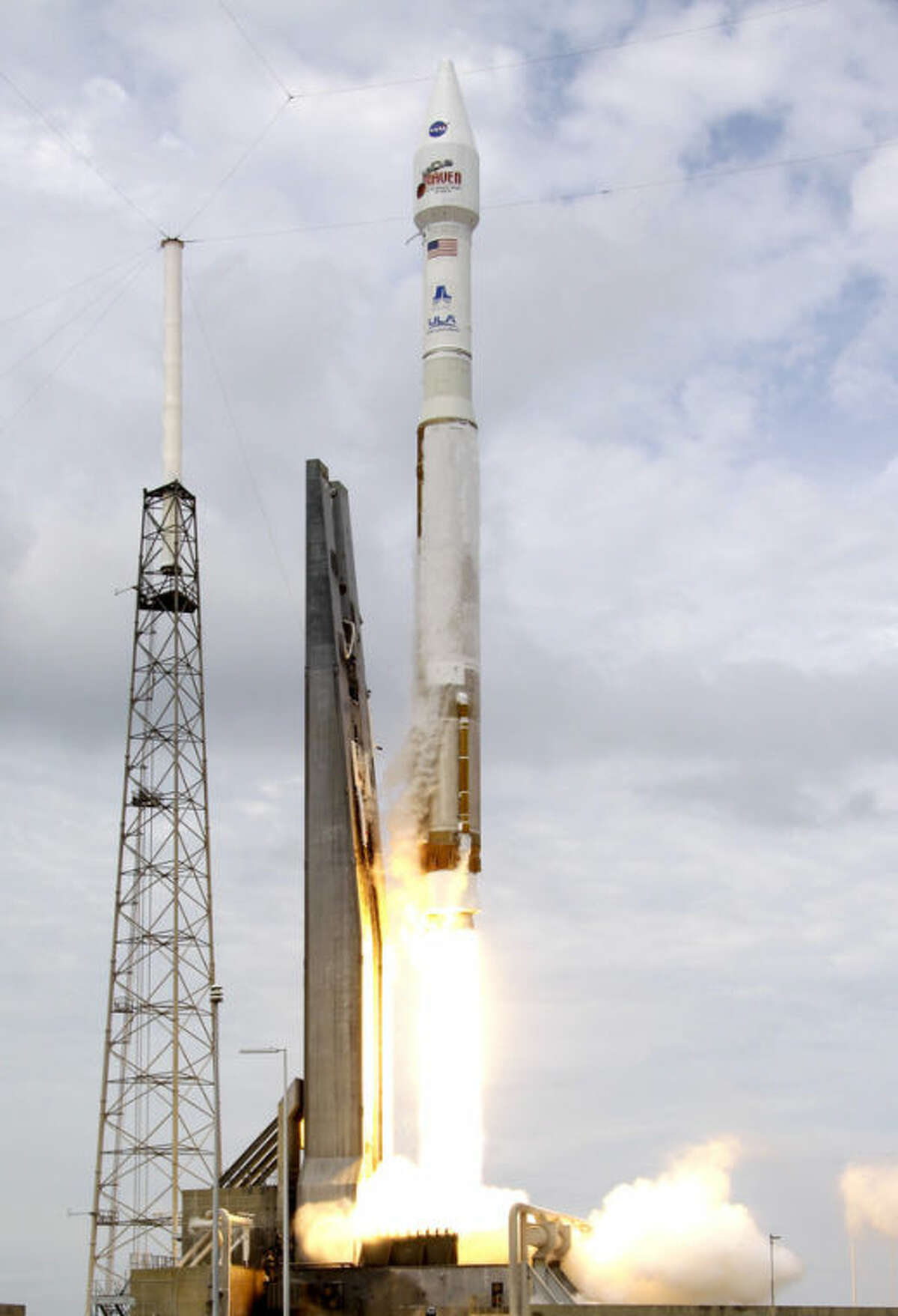 NASA's Maven, atop a United Launch Alliance Atlas 5 rocket, lifts off from Cape Canaveral Air Force Station, Monday, Nov. 18, 2013, in Cape Canaveral, Fla. The spacecraft will orbit Mars and study the planet's upper atmosphere. (AP Photo/John Raoux)