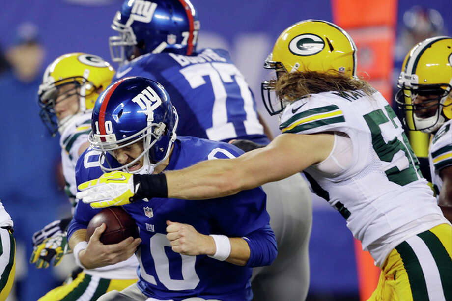 New York Giants quarterback Eli Manning (10) is sacked by Green Bay Packers' Clay Matthews (52) during the second half of an NFL football game Sunday, Nov. 17, 2013, in East Rutherford, N.J. (AP Photo/Seth Wenig) / AP