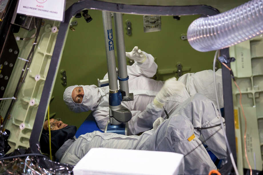 This photo provided by NASA shows NASA administrator Charles Bolden, foreground, and Scott McDade with Lockheed Martin, inspecting the Orion Multipurpose Crew Vehicle, which is being processed for its first test flight, Sunday, Nov. 17, 2013, at the Kennedy Space Center's Operation and Checkout Facility in Cape Canaveral, Florida. The spacecraft that will one day carry astronauts to study an asteroid and eventually on to Mars is being prepared for its maiden flight by engineers from NASA and Lockheed Martin. Orion's first exploration flight test is scheduled for late 2014. The Administrator is at the Kennedy Space Center for the launch of MAVEN to Mars, targeted for liftoff Monday, Nov. 18, at 1:28 p.m. EST. (AP Photo/NASA, Bill Ingalls) / (NASA/Bill Ingalls)