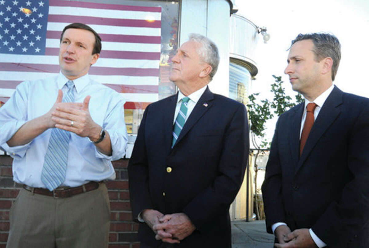 Hour photo / Matthew Vinci Mayor-elect Harry Rilling, center, and U.S. Senator Chris Murphy, left, meet with State Sen. Bob Duff at the Family Diner in Norwalk to discuss priorities and issues regarding the city of Norwalk.
