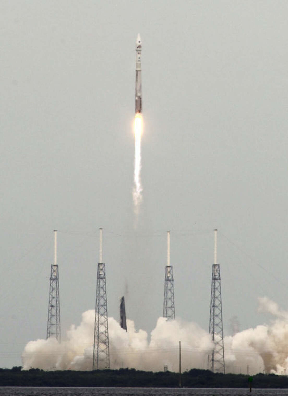 NASA's newest robotic explorer, Maven, atop a United Launch Alliance Atlas 5 rocket, lifts off from Cape Canaveral Air Force Station, Monday, Nov. 18, 2013, in Cape Canaveral, Fla. The spacecraft will orbit Mars and study the planet's upper atmosphere.(AP Photo/Terry Renna)