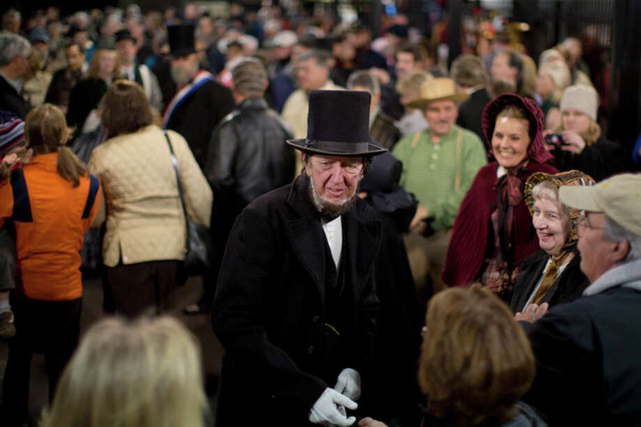 President Abraham Lincoln, portrayed by presenter Robert Costello is greeted Monday, Nov. 18, 2013, at the Gettysburg Train Station in Gettysburg, Pa. Tuesday, Nov. 19, marks the 150th anniversary of Lincoln's short speech that has gone on to symbolize his presidency and explain the sacrifices made by Union and Confederate forces during the U.S. Civil War. (AP Photo/Matt Rourke) / AP