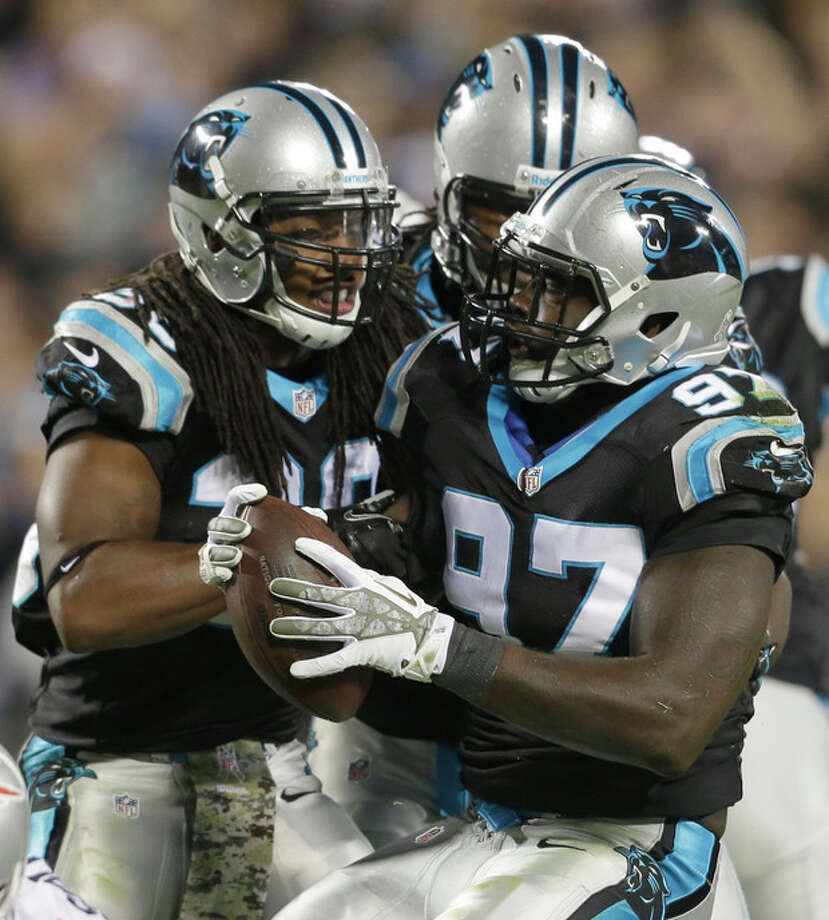 Carolina Panthers' Mario Addison (97) celebrates his fumble recovery with teammates during the first half of an NFL football game against the New England Patriots in Charlotte, N.C., Monday, Nov. 18, 2013. (AP Photo/Gerry Broome) / AP