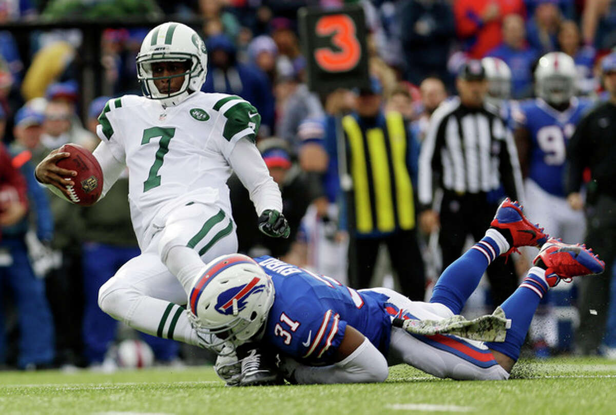 New York Jets quarterback Geno Smith (7) is sacked by Buffalo Bills free safety Jairus Byrd (31) during the first half of an NFL football game on Sunday, Nov. 17, 2013, in Orchard Park, N.Y. (AP Photo/Heather Ainsworth)