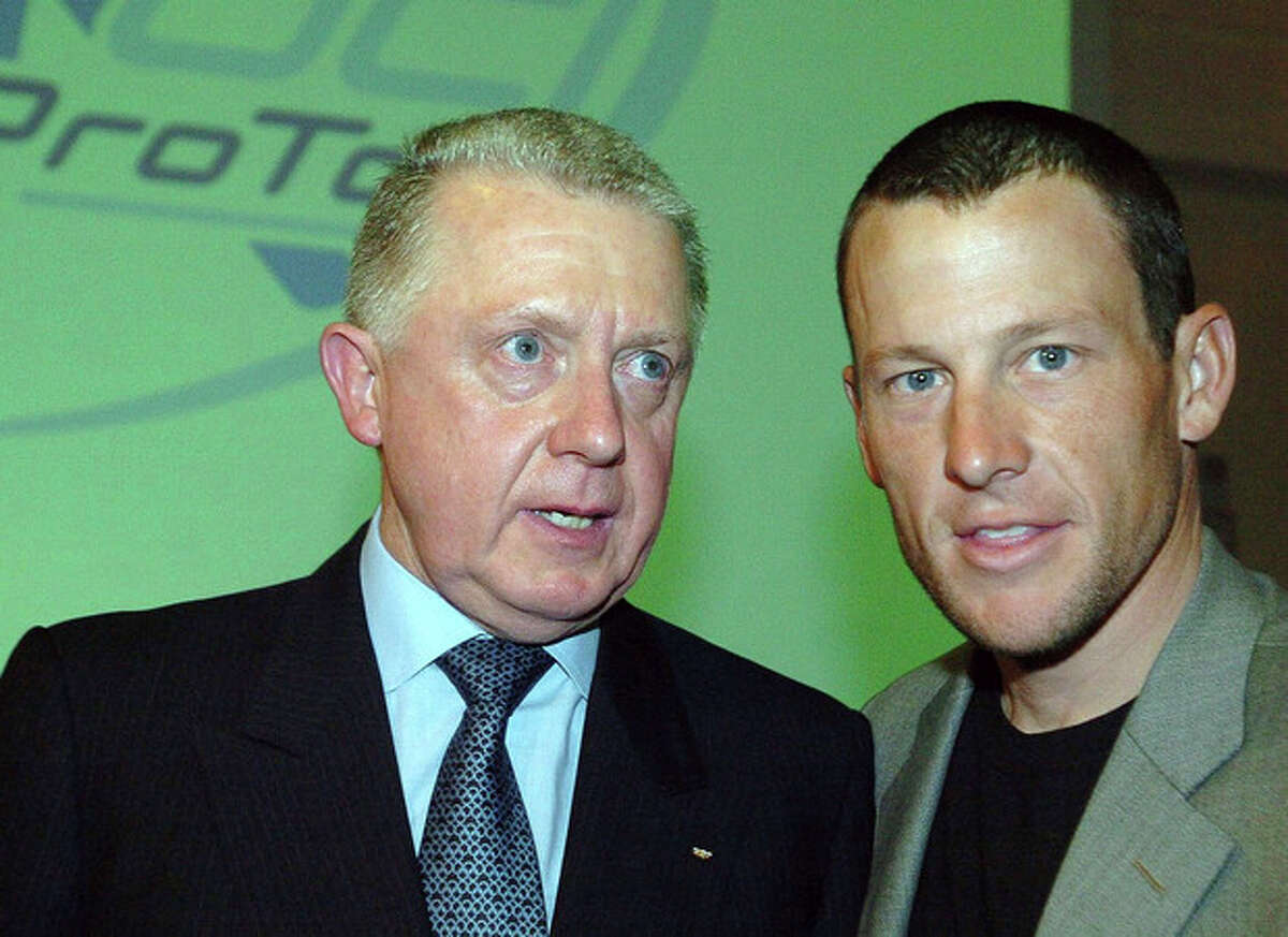 FILE - This March 5, 2005, file photo shows Hein Verbruggen, left, president of the International Cycling Union, and cyclist Lance Armstrong, at the launch of the Cycling Pro Tour, in Paris. Armstrong claims Verbruggen instigated a cover-up of his doping at the 1999 Tour de France. (AP Photo/Christophe Ena, File)