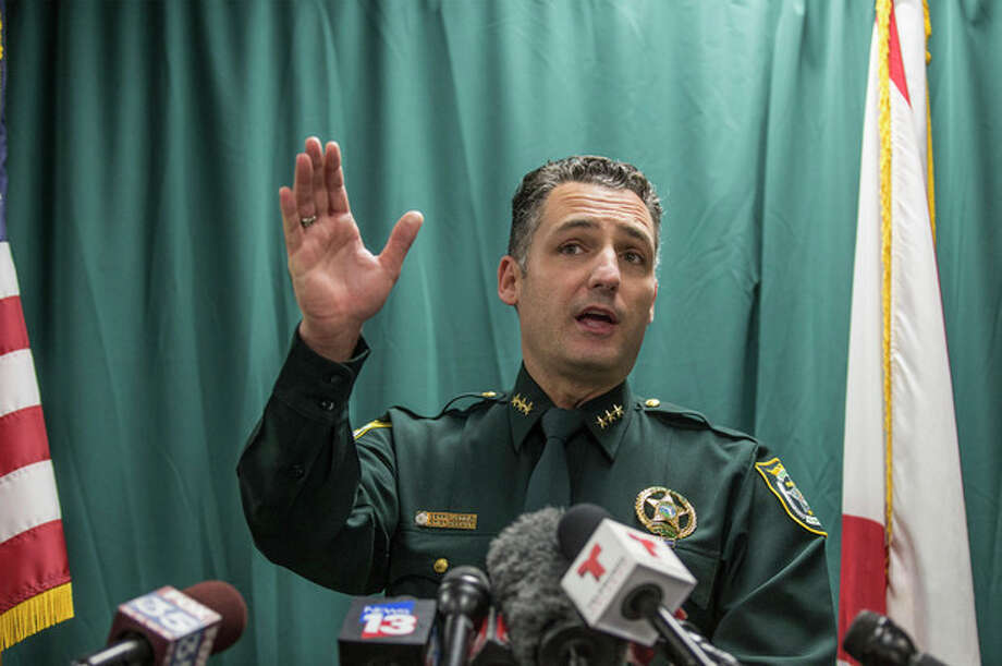 Seminole County Chief Deputy Dennis Lemma talks with media, Monday, Nov. 18, 2013, in Orlando, Fla., about the latest arrest of George Zimmerman, who was acquitted in July of criminal charges in the fatal shooting of Trayvon Martin. Zimmerman was charged Monday with assault after deputies were called to the home where he lived with his girlfriend, who claimed he pointed a shotgun at her during an argument, authorities said. (AP Photo/Willie J. Allen Jr.) / FR170803 AP