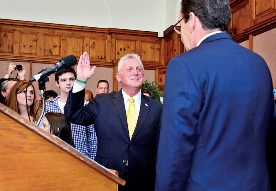 Hour photo / Erik Trautmann Harry Rilling is sworn in as mayor of Norwalk by Connecticut governor Dannel Malloy Tuesday afternoon in the Community Room at City Hall.