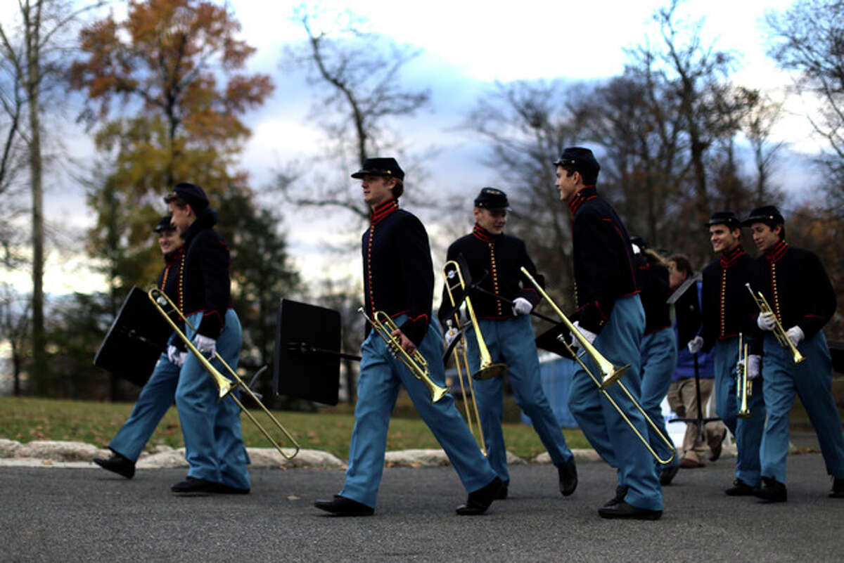 Band members arrive before a ceremony commemorating the 150th anniversary of the dedication of Soldiers?' National Cemetery and President Abraham Lincoln's Gettysburg Address, Tuesday Nov. 19, 2013, in Gettysburg, Pa. Lincoln's speech was first delivered here nearly five months after the pivotal battle which was the Civil War's bloodiest conflict with more than 51,000 casualties. (AP Photo/Matt Rourke)