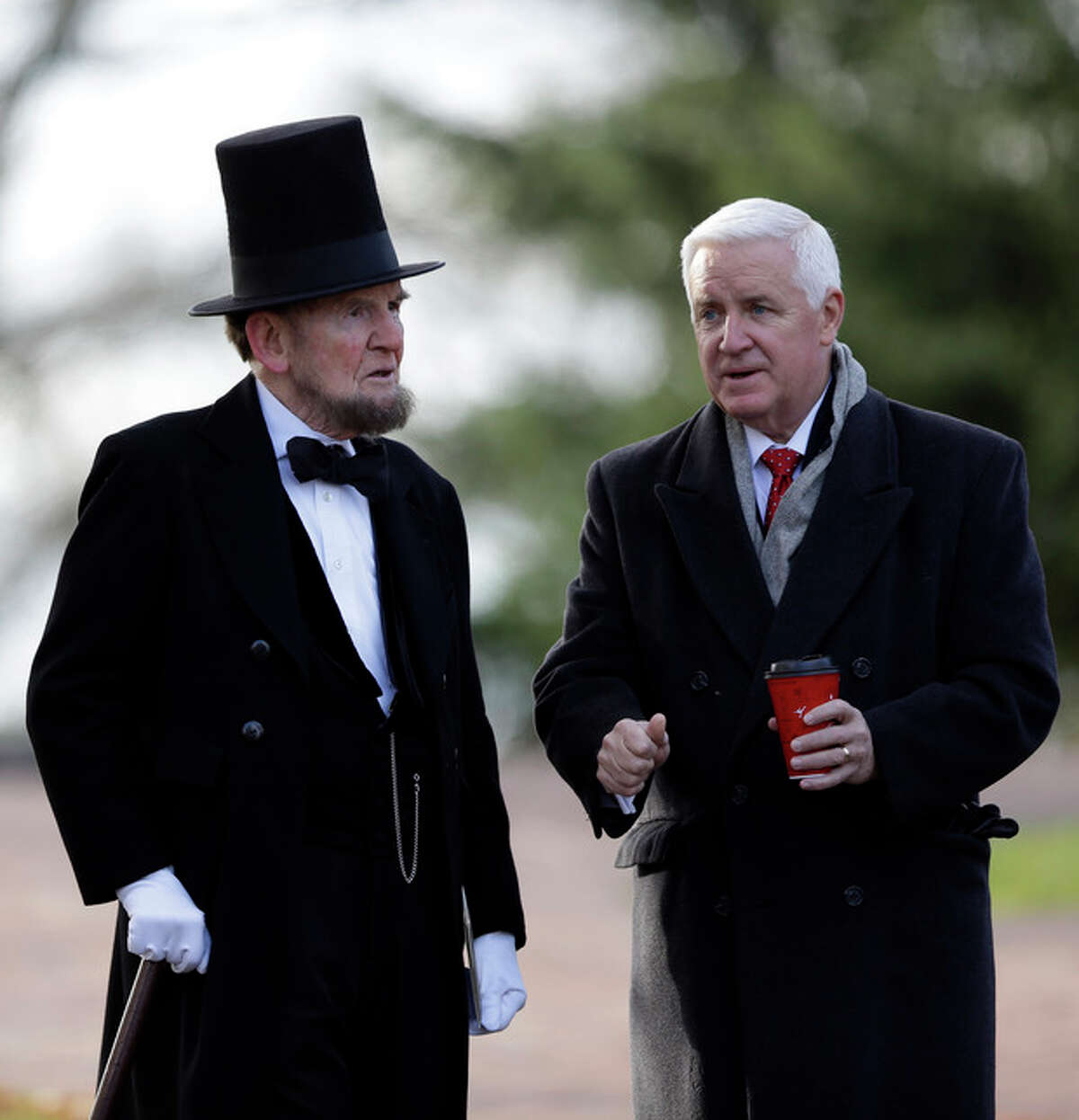 Pennsylvania Gov. Tom Corbett, right, speaks with James Getty, portraying President Abraham Lincoln, before a ceremony commemorating the 150th anniversary of the dedication of the Soldiers?' National Cemetery and President Abraham Lincoln's Gettysburg Address, Tuesday Nov. 19, 2013, in Gettysburg, Pa. Lincoln's speech was first delivered in Gettysburg nearly five months after the major battle that left tens of thousands of men wounded, dead or missing. Getty is scheduled to deliver the Gettysburg Address at Tuesday's ceremony. (AP Photo/Matt Rourke)
