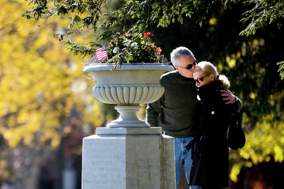 Tom Stack accompanied by Jill MacKenzie pays his respects to his great great uncle a solder from the 1st Minnesota at Soldiers' National Cemetery Monday, Nov. 18, 2013, in Gettysburg, Pa. Nov. 19th marks the 150th anniversary of President Abraham Lincoln's short speech that has gone on to symbolize his presidency and explain the sacrifices made by Union and Confederate forces during the U.S. Civil War. (AP Photo/Matt Rourke) / AP
