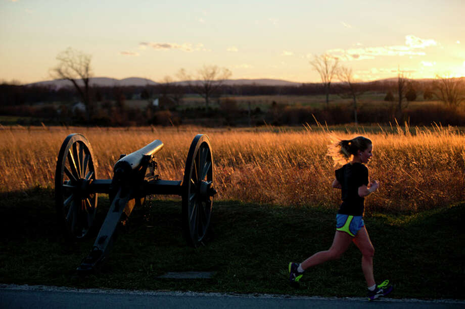 A runner passes through Gettysburg National Military Park, Monday, Nov. 18, 2013, in Gettysburg, Pa. Nov. 19th marks the 150th anniversary of President Abraham Lincoln's short speech that has gone on to symbolize his presidency and explain the sacrifices made by Union and Confederate forces during the U.S. Civil War. (AP Photo/Matt Rourke) / AP