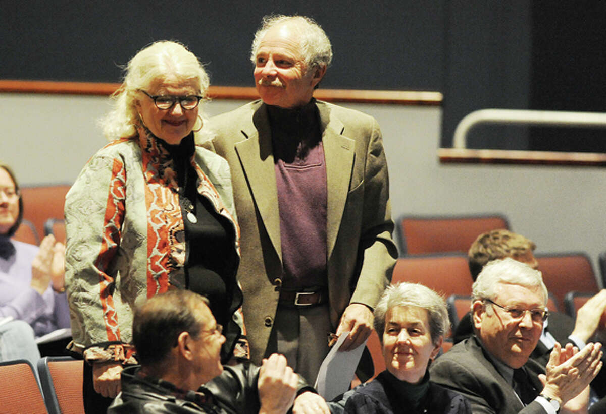 Property owners, Peter and Florence Keiser are acknowledged at a special town meeting at the Clune Center in Wilton to discuss the preservation of a 39-acre open space property on Cannon Road. photo/Matthew Vinci