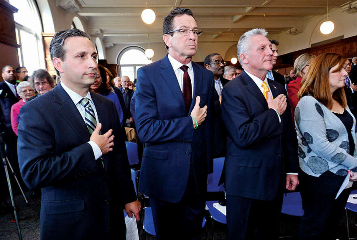 Hour photo / Erik Trautmann State Senator Bob Duff, CT Governor Dannell Malloy and Harry Rilling listen to the national anthem before Rilling is sworn in as mayor of Norwalk by the governor Tuesday afternoon in the Community Room at City Hall.