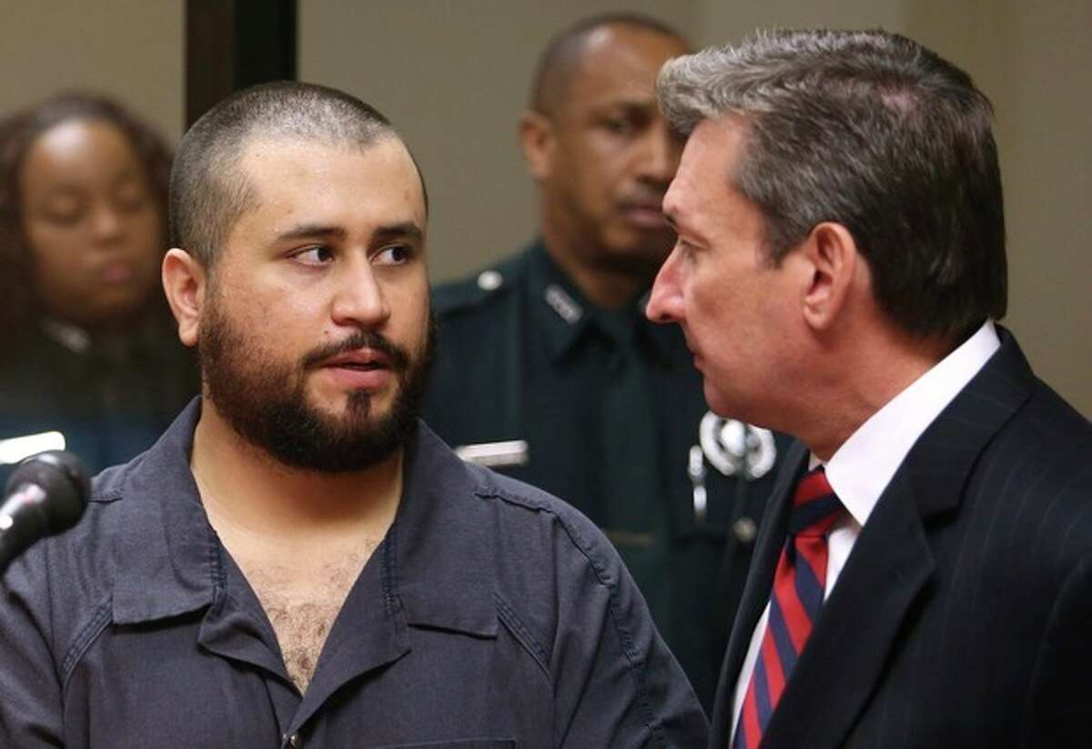 George Zimmerman, acquitted in the high-profile killing of unarmed black teenager Trayvon Martin, faces his defense counsel Jeff Dowdy in court Tuesday, Nov. 19, 2013, in Sanford, Fla., during his hearing on charges including aggravated assault stemming from a fight with his girlfriend. (AP Photo/Orlando Sentinel, Joe Burbank, Pool)