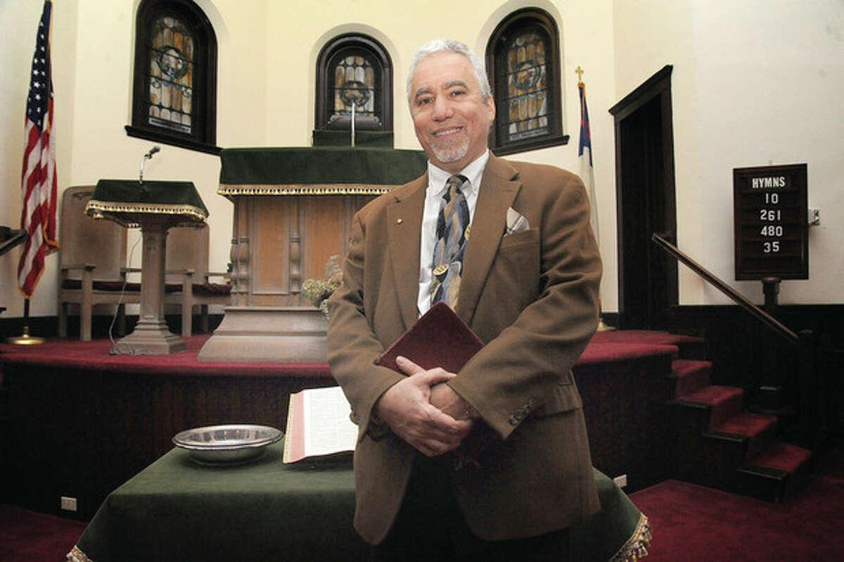 Hour photo / Matthew Vinci John Cardamone is the new minister of the Calvin Reformed Church in Norwalk.