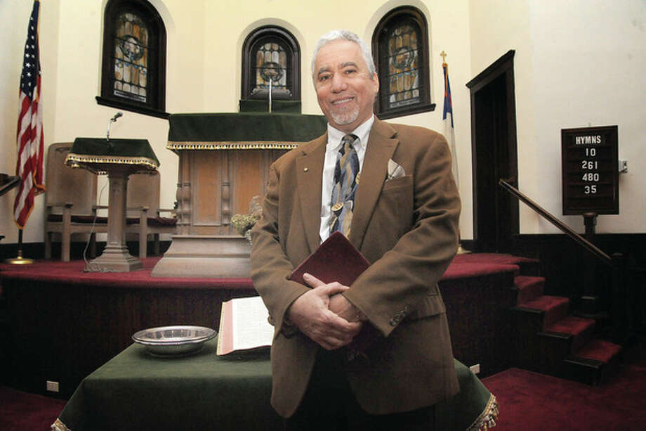 Hour photo / Matthew VinciJohn Cardamone is the new minister of the Calvin Reformed Church in Norwalk.