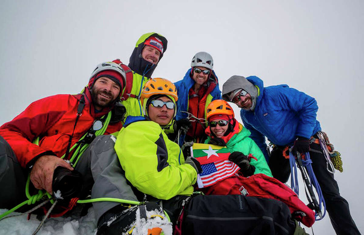 In this photo taken in September 2013, members of a U.S.- Myanmar expedition, from left, Mark Fisher, Eric Daft, Poe Pin, Andy Tyson, Molly Tyson, Chris Nance pose for photos on the peak of Mount Gamlang, in Myanmar. The team believes Mount Gamlang, known as the country?'s second highest peak, is higher than previously thought, which, if confirmed, could make it the country?'s highest mountain. (AP Photo/Mark Fisher)