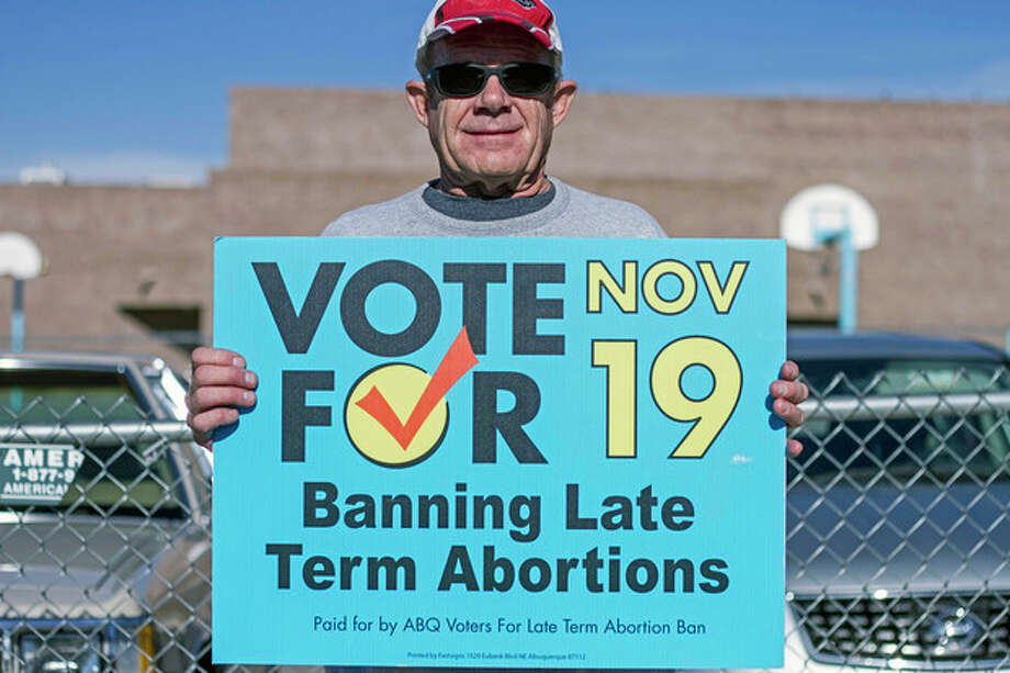 Monte Harms, of Albuquerque, N.M., advocates Albuquerque's late term abortion ban outside of a voting site at Eisenhower Middle School in Albuquerque, N.M., Tuesday, Nov. 19, 2013. Albuquerque voters will decide whether to ban abortions after 20 weeks following an emotional and graphic campaign that has included protests and hundreds of thousands of dollars on television and radio ads that have brought out more than twice as many early voters as the recent mayoral elections. (AP Photo/Juan Antonio Labreche) / AP