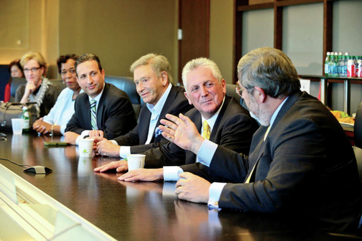 Hour photo / Erik Trautmann Diageo's Guy Smith, right, chats with mayor elect Harry Rilling during a meeting local with business leaders Diageo in Norwalk Tuesday.