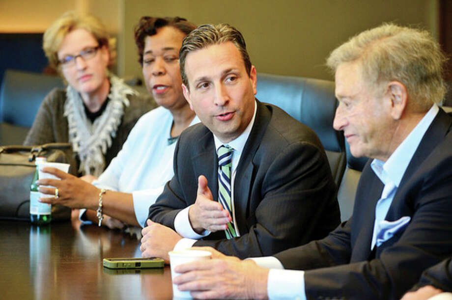 Hour photo / Erik Trautmann State Senator Bob Duff who is on the transition team for mayor elect Harry Rilling chats with business leaders during a meeting with Rilling and others at Diageo in Norwalk Tuesday. / (C)2013, The Hour Newspapers, all rights reserved