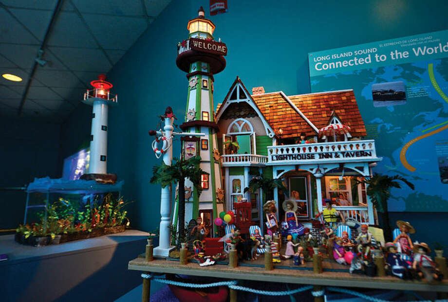 Hour photo / Erik Trautmann The entry, Lighthouse Inn & Tavern by Norwalk resident Jo Stucker, in the Maritime Aquarium's 12th annual Festival of Lighthouses Contest which awards an aquarium family membership for each displayed lighthouse and $3,300 in prizes.